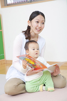 Nursery school boys and nursery teacher to read picture books Baby