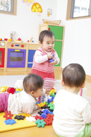 Nursery school children playing with toys Baby