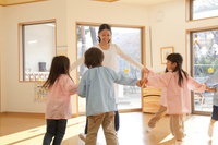 Kindergarten teachers and kindergarten children dancing in a circle Stock photo [2415915] Happy