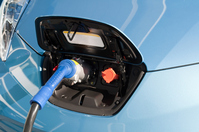 Electric vehicle charging Stock photo [2423324] Electric