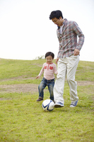 Children parent-child to kick the ball Stock photo [2425584] Family