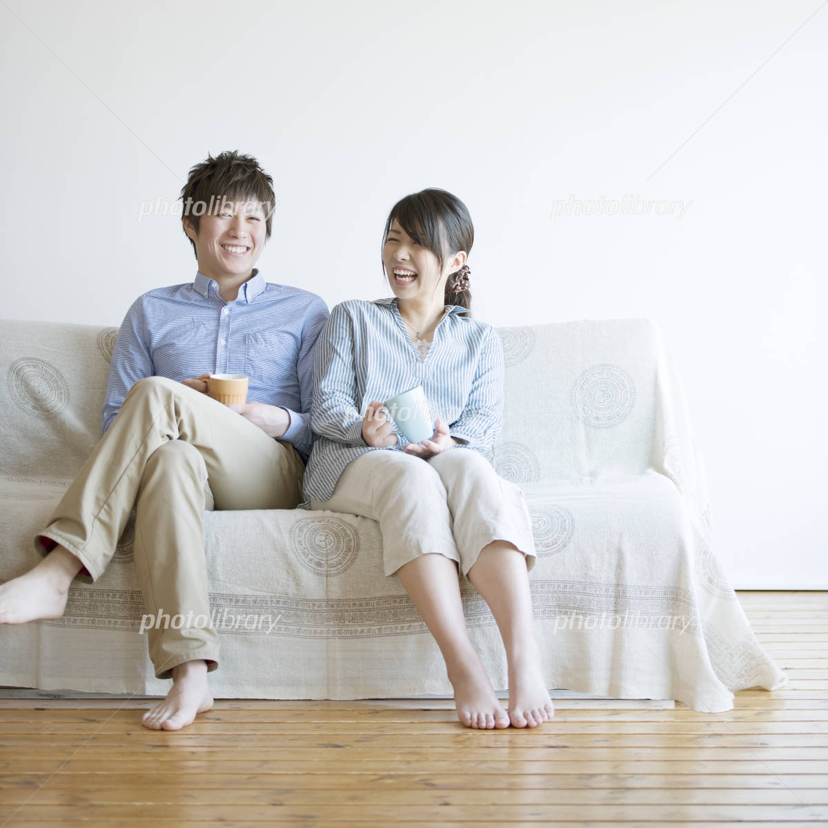 Couples smile sitting on the sofa Photo