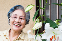 Senior women rejoice in flowering of lily Stock photo [3676303] Woman