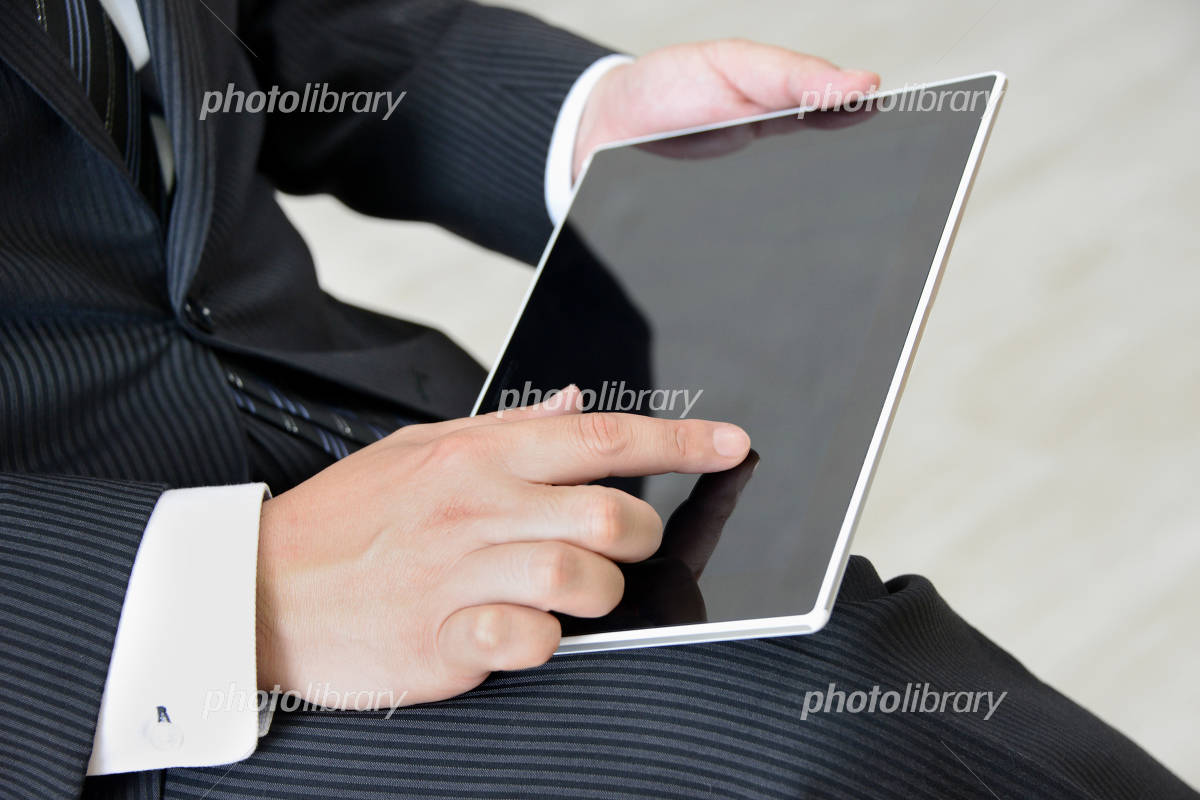 Businessman to use tablet Photo