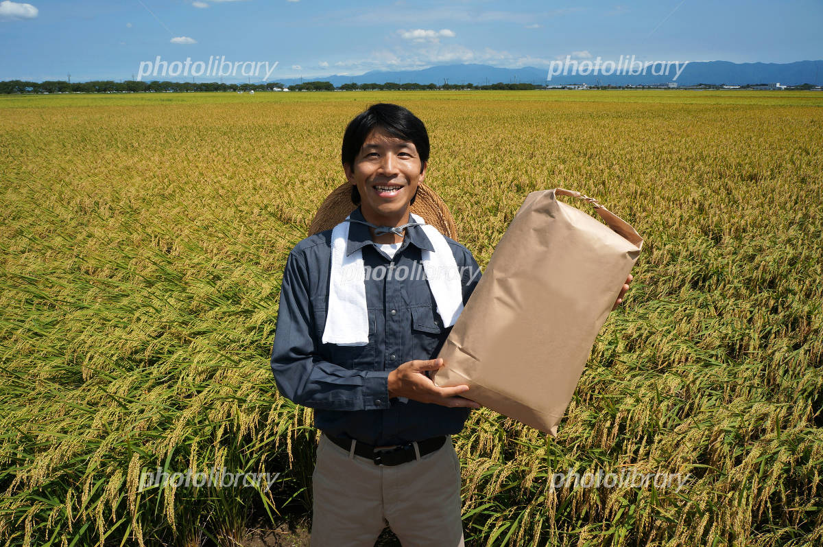 Men and rice bags Photo
