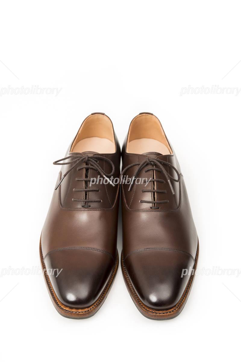 男性用の茶色の革靴 正面 写真素材 [ 4065620 ] , フォトライブ