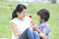 Women and children with a heart in the meadow Stock photo [4068763] Parent