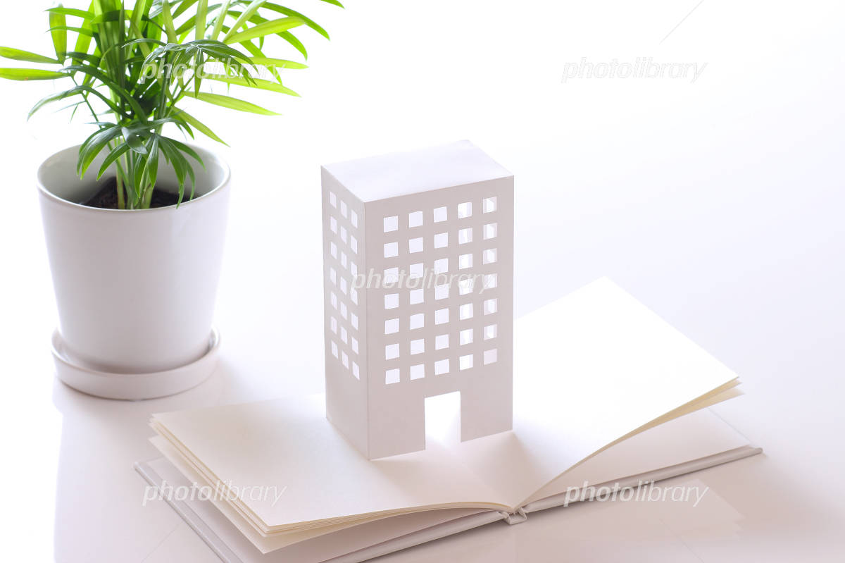 The model of the envelope and the building in white background Photo