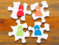 The four people in the form of paper meeting and teamwork concept four puzzle pieces and human type of paper craft wood grain background to the business discussion Stock photo [4237403] Meeting