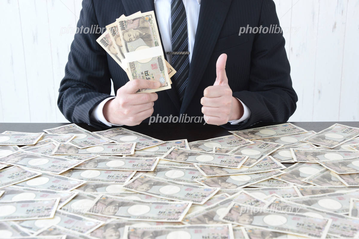 Businessman in hand a lot of money Photo