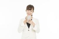 Businesswoman Sumaho operation smile white back Stock photo [4287154] Sumaho