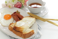 Cream cheese toast and sausages for breakfast  Photo