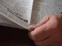 Hand to read a newspaper Stock photo [1289974] Old