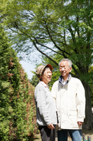 Elderly couple to walk through the green Stock photo [1384970] Elderly