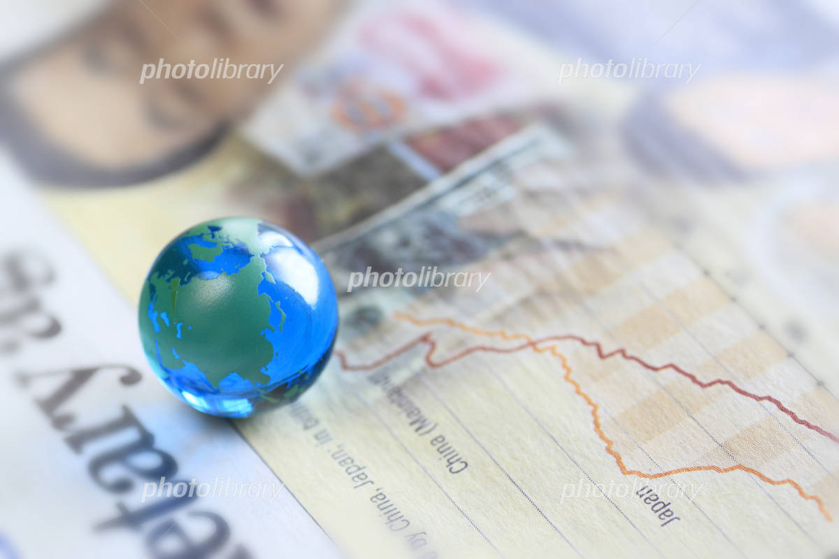 Economic newspapers and Earth Photo