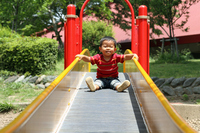 Toddler playing on slide (1-year-olds) Stock photo [1577822] Infant