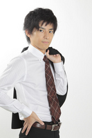Businessman put a jacket on shoulder Stock photo [1584446] Businessman