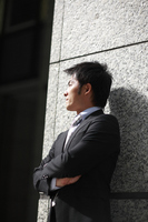 Young business man standing against a wall Stock photo [1685067] Business
