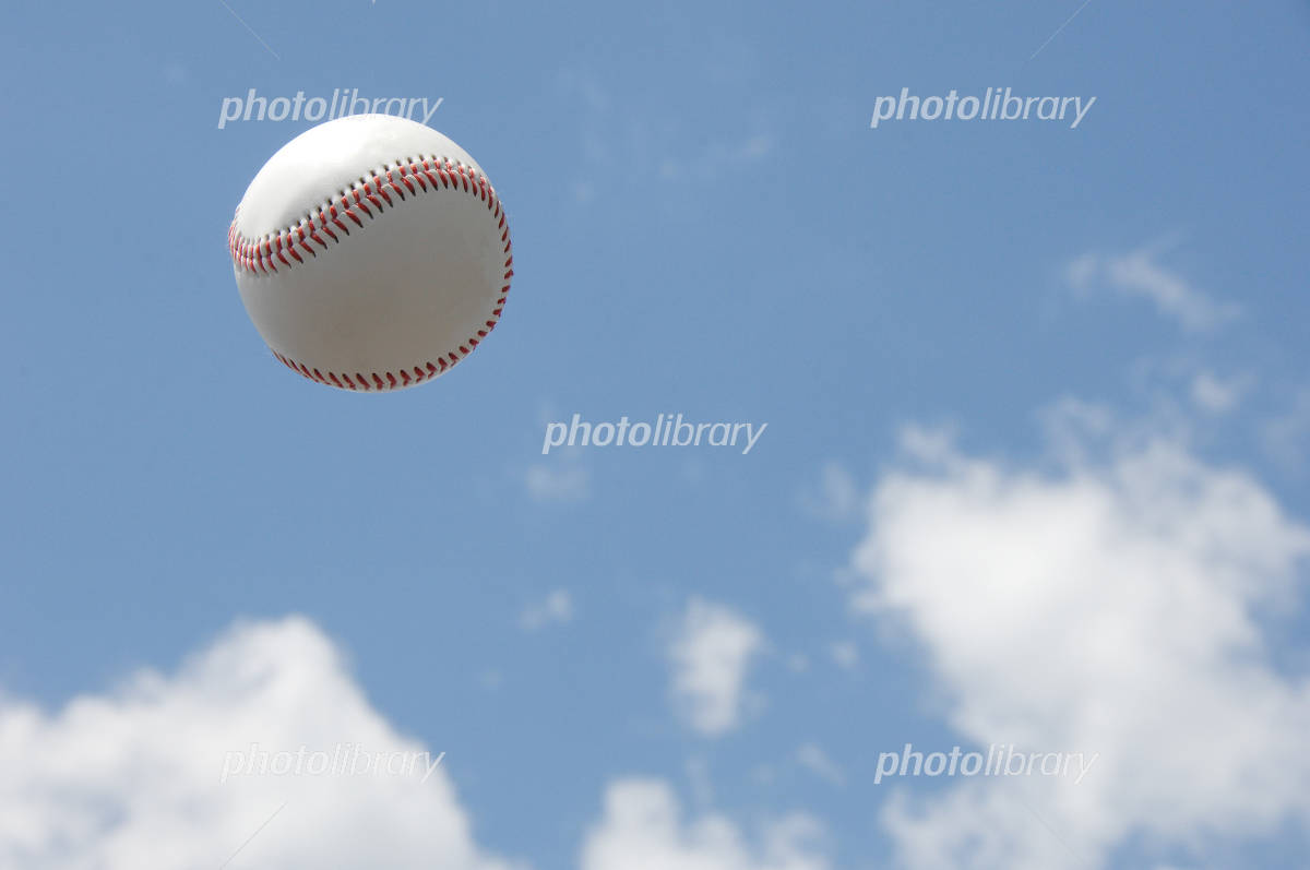 Blue sky and baseball Photo