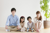 Family of four sitting on the floor Stock photo [2077067] Person