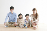 Family of four sitting on the floor Stock photo [2077080] Person
