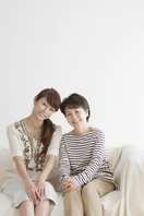 The smile sitting on the sofa mother and daughter Stock photo [2077333] Person