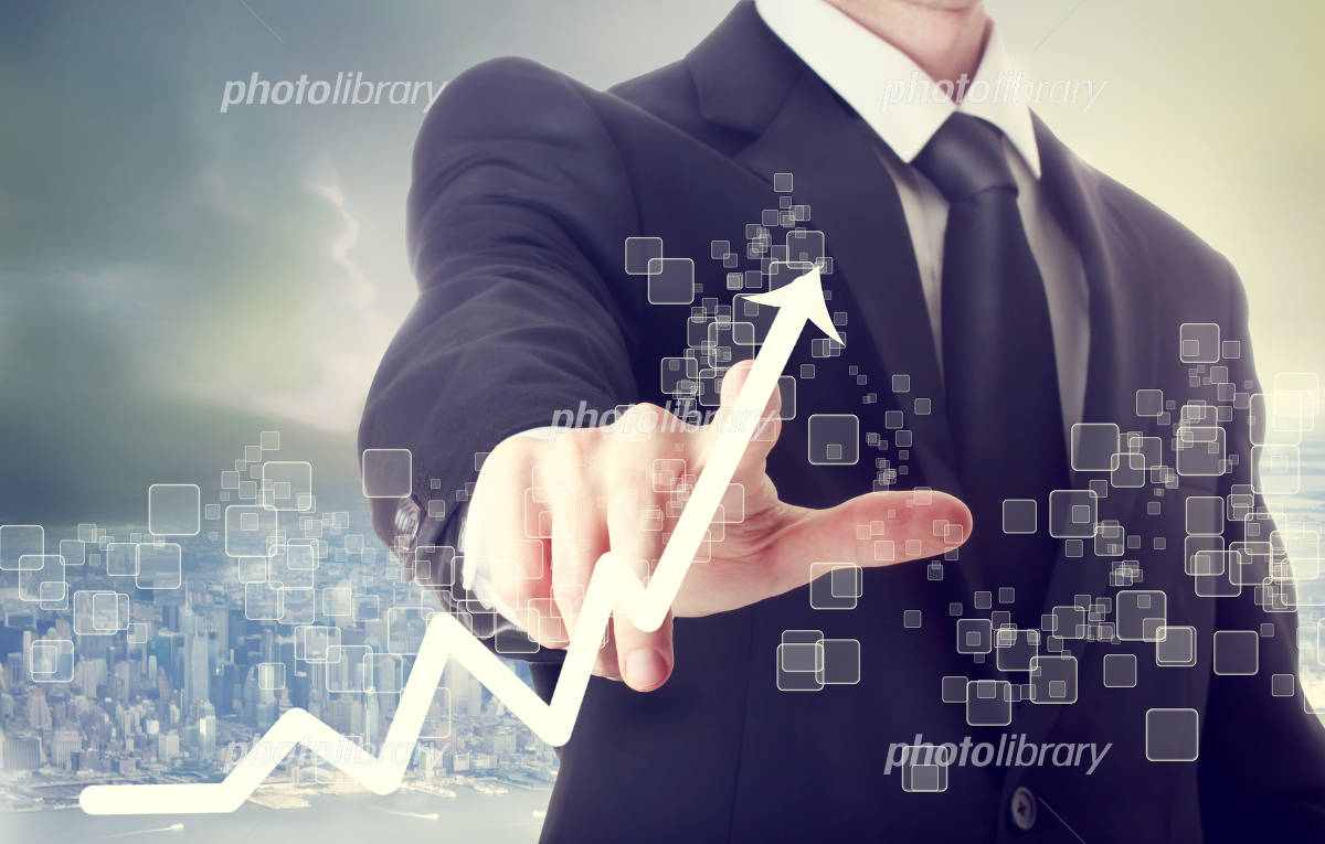 Graphs and businessman Photo
