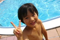 Boy of V sign at the poolside Stock photo [2301581] Pool