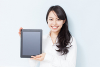 Women show the screen of the tablet PC Stock photo [2425925] Female