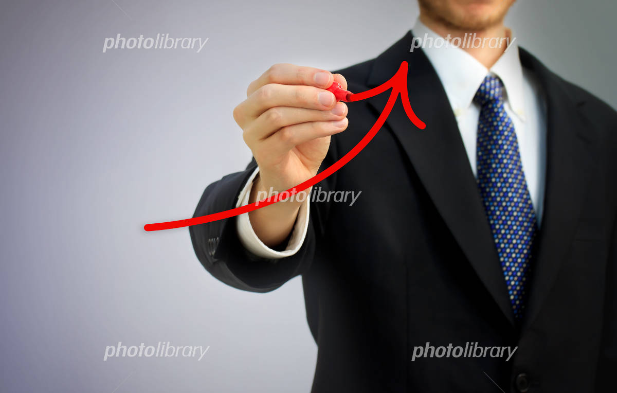 Businessman Write a red arrow Photo