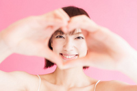 Girl to make a heart in hand Stock photo [2545488] Female