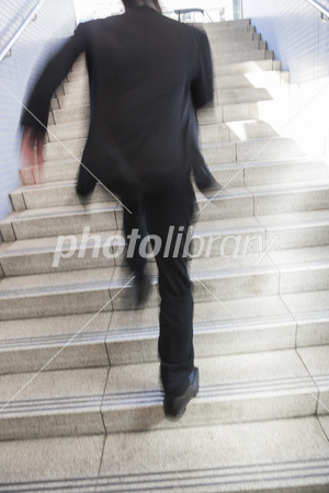 Businessman to run up the stairs Photo