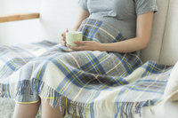 Pregnant woman sitting on sofa Stock photo [2747777] Pregnant