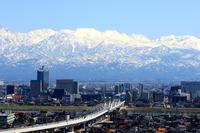 Tateyama mountain range and the Hokuriku Shinkansen seen from Toyama Kurehayama Stock photo [3687870] Tateyama