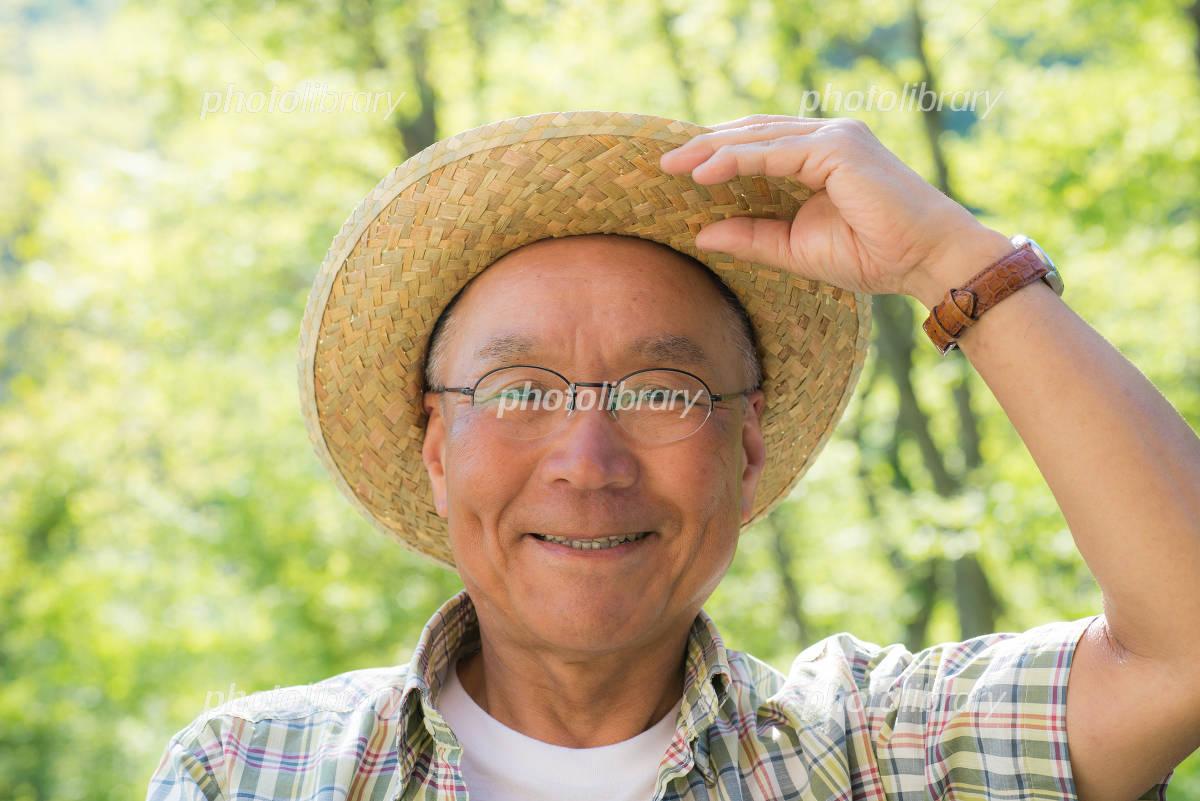 Senior smile in the fresh green Photo