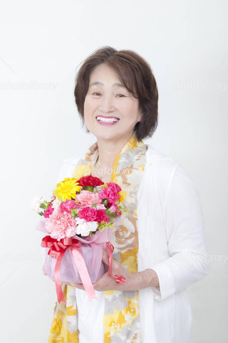 Senior with a bouquet Photo