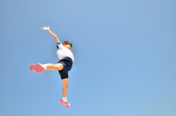 Girl to jump in the blue sky (gym suit) Stock photo [4244274] girl