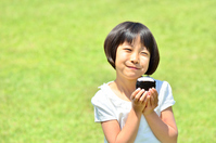 Girl eating rice balls on the lawn open space Stock photo [4299708] children