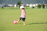 Children kicking a ball barefoot Stock photo [4303190] Rear