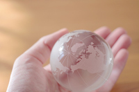 Hand holding a globe of glass Stock photo [4613615] Close-up