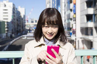 Enter a young woman smartphone screen smile Stock photo [4944631] input