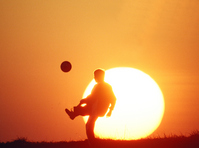 Soccer boy and sunsets Stock photo [334123] Sport