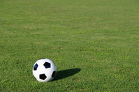 Soccer ball rolling on the ground Stock photo [887122] Ground