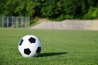 Soccer ball rolling on the ground Stock photo [887130] Ground
