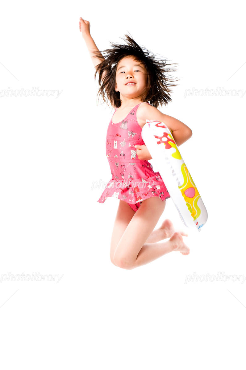 Swimwear children to jump with a float Photo