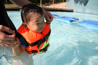 Swim in the pool infants (1-year-olds) Stock photo [1393615] Infant
