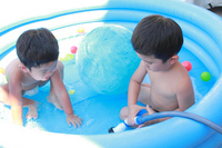 Brothers playing in the pool Stock photo [1491893] Boys