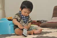 Baby of 10 months to play with the TV remote control Stock photo [1491943] Tv