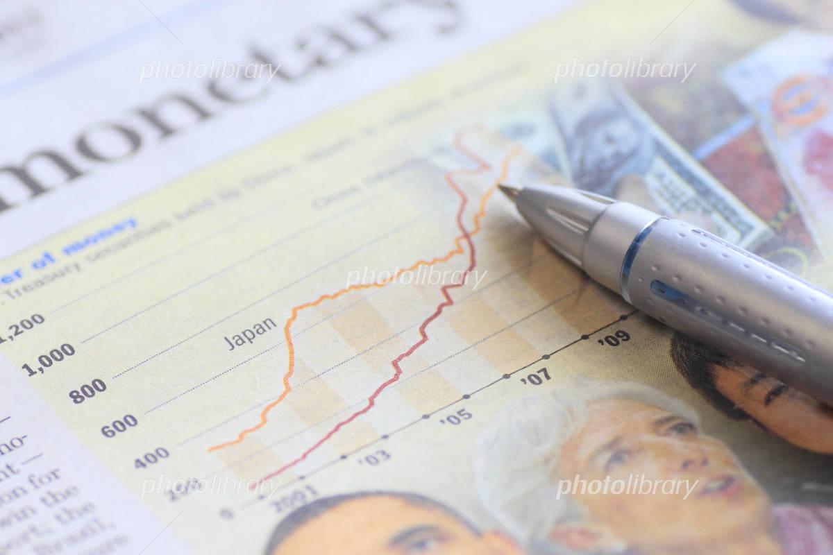Economic newspaper and pen Photo