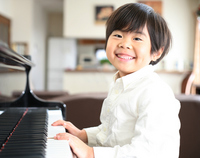 Boy playing the piano Stock photo [1771743] Piano